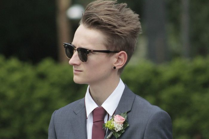 Teenage at a wedding Portrait Page Boy Trees Tie Suit Hair Style Quiff Hair Up Ear Piercing Flowers Serious Blurred Background Focus Wedding Day Wedding Photography Wedding EyeEm Selects One Person Sunglasses Eyeglasses  Focus On Foreground Real People Outdoors Young Men Young Adult Headshot Men Day Close-up People