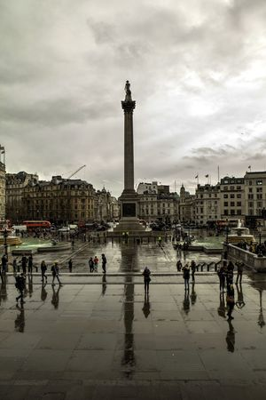 Trafalgar Square after a storm Adults Only Architecture Building Exterior Built Structure City Day Men Nelson's Column Outdoors People Rain Sky Statue Tower Town Square Trafalgar Square Travel Destinations Water