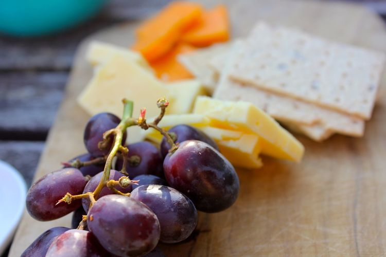 cheese, grapes and cracker snack Close-up Day Focus On Foreground Food Food And Drink Freshness Fruit Grape Healthy Eating No People Outdoors Ready-to-eat Table