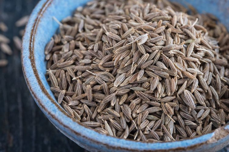 Close-up of cumin seeds in bowl on table