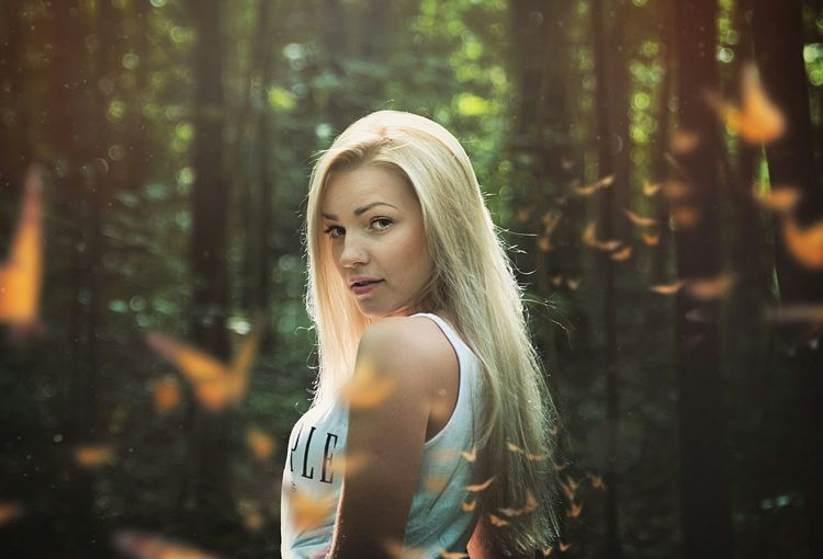 Portrait of a beautiful woman in the forest