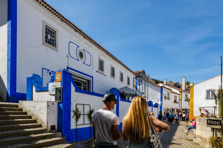 Architecture Blue Bonding Building Exterior Built Structure Day Leisure Activity Lifestyles Men Outdoors Real People Rear View Sky The Architect - 2017 EyeEm Awards Togetherness Two People Women Óbidos