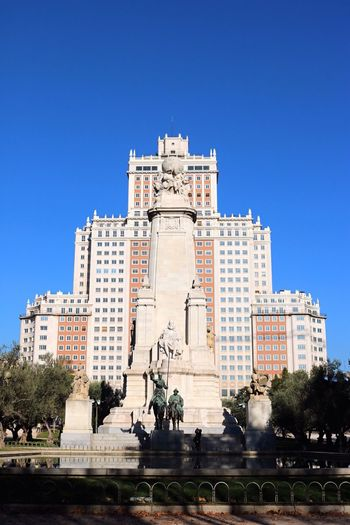 Architecture Building Exterior Built Structure Clear Sky History Travel Destinations Blue City Outdoors Low Angle View Tourism Monument Statue Tree Sky Sculpture Day No People Don Quijote Sanchopanza
