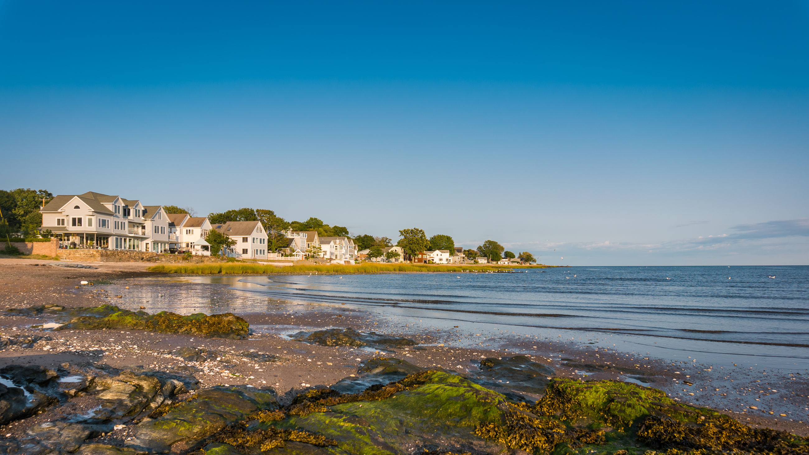 sea, water, beach, architecture, nature, clear sky, sky, tranquility, outdoors, holiday, no people, blue, scenics, built structure, beauty in nature, day, tree