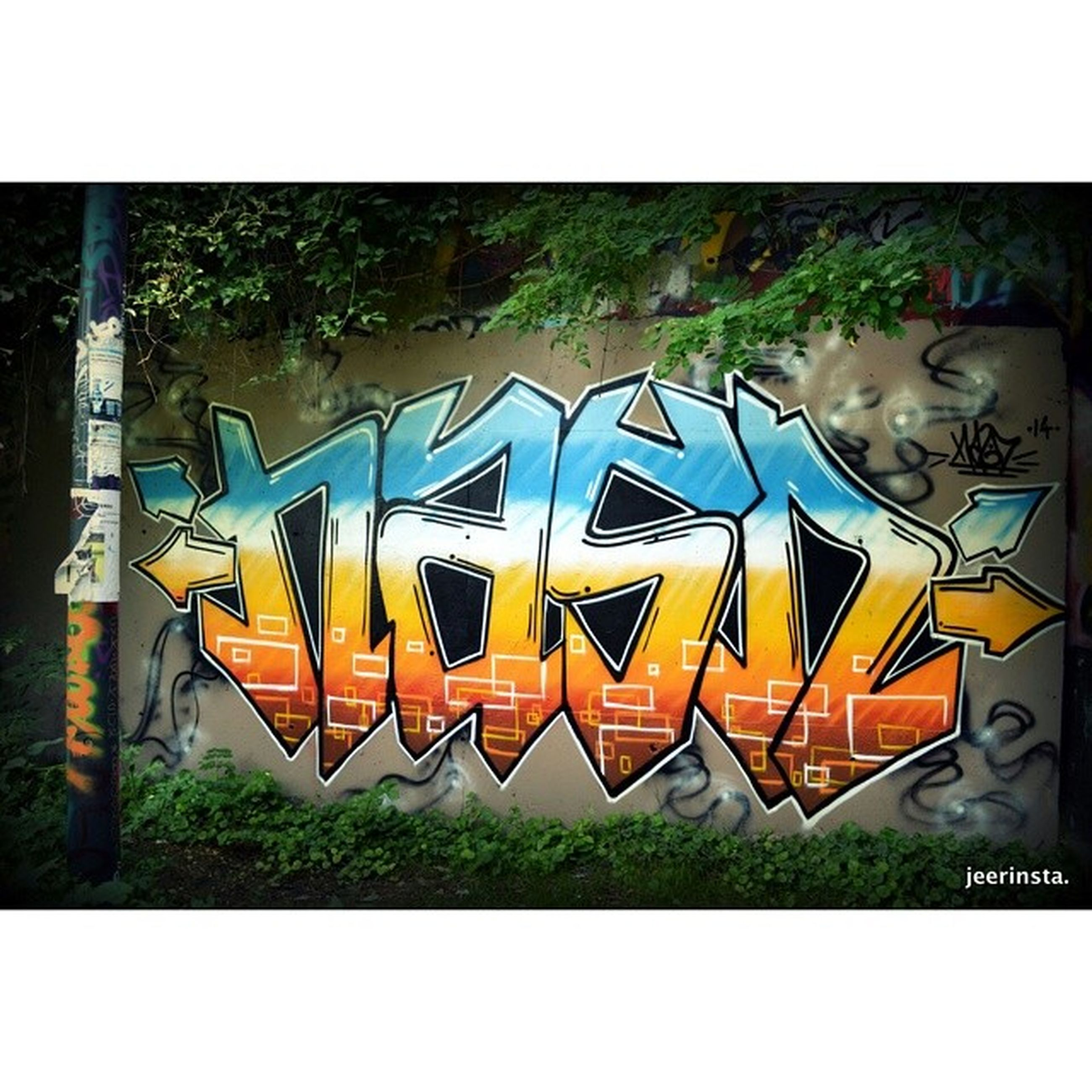graffiti, transfer print, art, creativity, art and craft, auto post production filter, multi colored, human representation, built structure, building exterior, street art, text, architecture, yellow, western script, wall - building feature, mural, animal representation, day