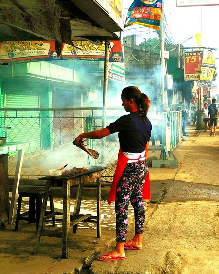 Full Length Outdoors One Person Real People Lifestyles One Woman Only Walking City Adults Only Only Women Road People Frying Food Streetphotography Smokey Meat Food Styling Street Food Streetphotography_bw Street Food Worldwide Selling On The Street