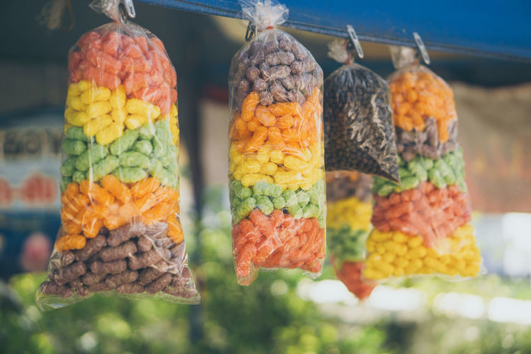Close-up of fruits hanging in row