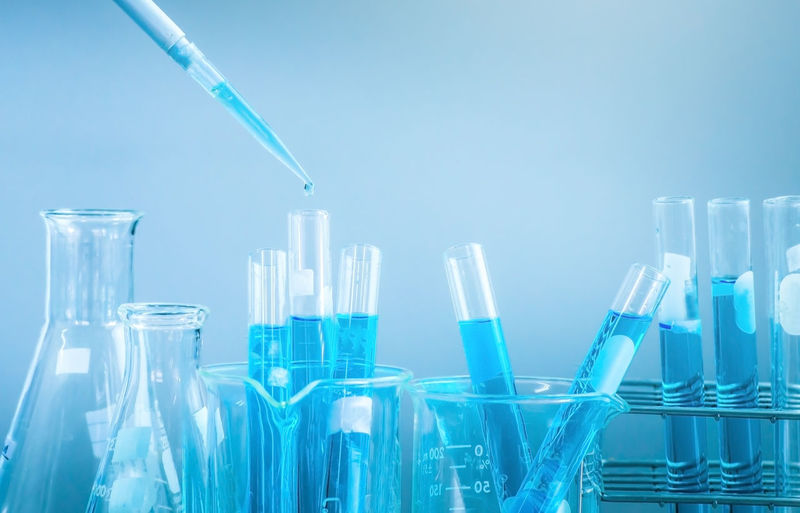 Analyzing Biochemistry Biology Biotechnology Blue Blue Background Chemistry Close-up Drop Education Glass - Material Healthcare And Medicine Indoors  Laboratory Laboratory Glassware Medical Research No People Research Science Scientific Experiment Studio Shot Test Tube Transparent