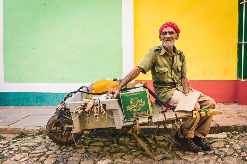 The Portraitist - 2018 EyeEm Awards The Traveler - 2018 EyeEm Awards The Street Photographer - 2018 EyeEm Awards Focus On The Story Adult Cap Colorful Cuba Front View Happiness Lifestyles Looking At Camera One Person Outdoors Portrait Portrait Photography Real People Senior Adult Sitting Smiling Street Street Life Street Photography Street Portrait Streetphotography