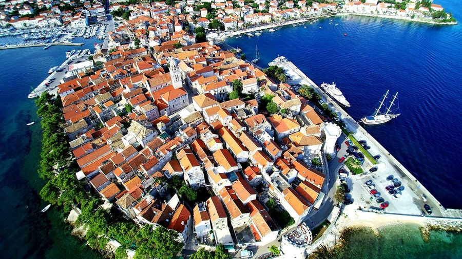 High Angle Shot Of Townscape By The Sea