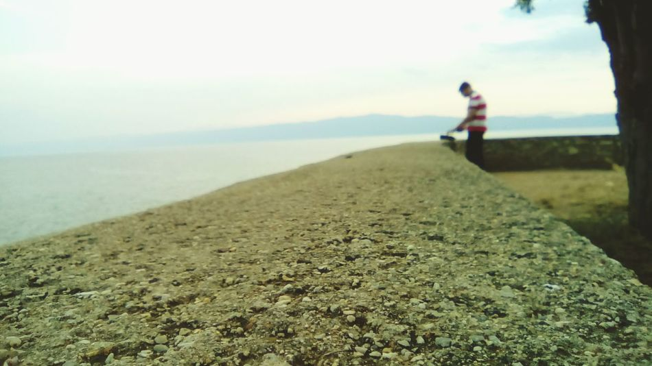 Hanging Out Taking Photos Check This Out Hello World Hi! Enjoying Life Clouds Nature Sky Landscape Light Nature_collection Ohrid Macedonia Wall Big Wall Person Perspective Photography Perspective Lake Red And White Blouse