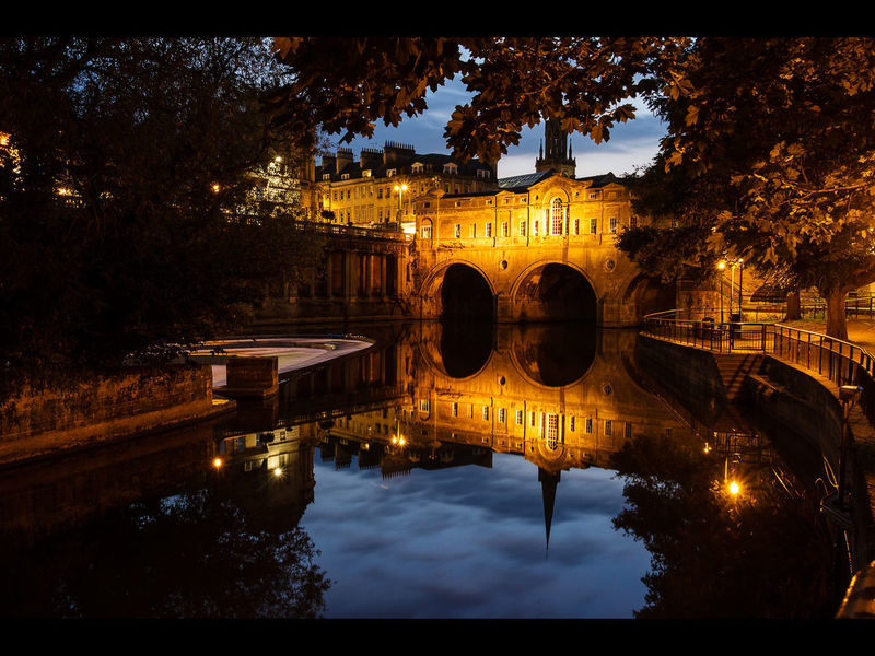 Pultney Bridge in Bath at dusk Reflection Water Arch Architecture Tree Bridge - Man Made Structure River Night Built Structure Outdoors No People Cityscape Travel Destinations Gold Colored City Reflecting Pool Illuminated Building Exterior Sky First Eyeem Photo