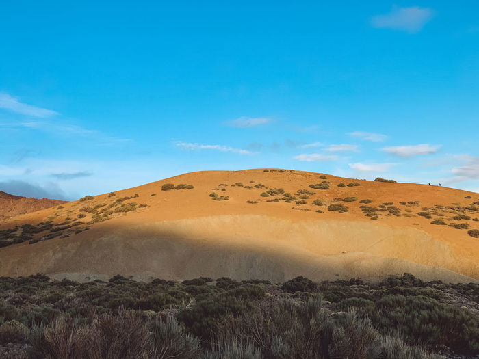 Scenic view of arid landscape against sky