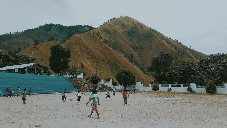 Batak Toba kids and playing football Batak  Bataknese Lake Toba Kids Football Tree Beach Sand Mountain Sport Sky Scenics