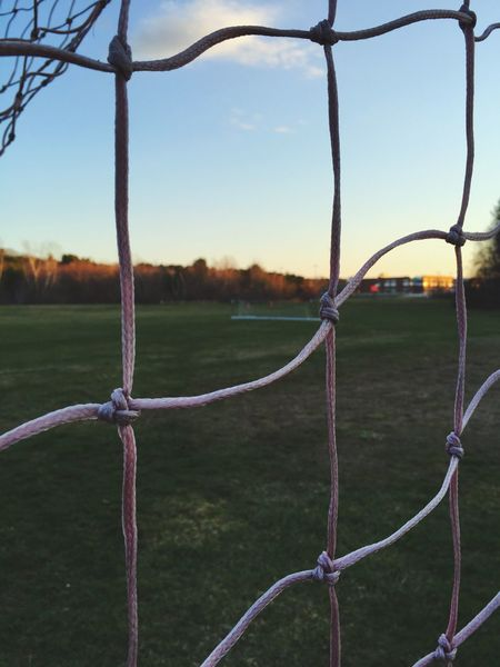 Goal High School Sports Soccer Field Outdoors Pastel Pink Net Sports Equipment Sports Field Green Shootermag Peaking Through Grass Peaking Distance Distant