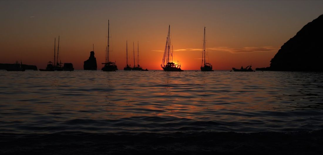 Ibiza Benirras Ibiza Beach Benirrás Beach Water Nautical Vessel Sea Beauty Sunset Dawn Gold Beach Arrival Sailboat Mast Sailing Sailing Boat Sailing Ship Yachting Seascape