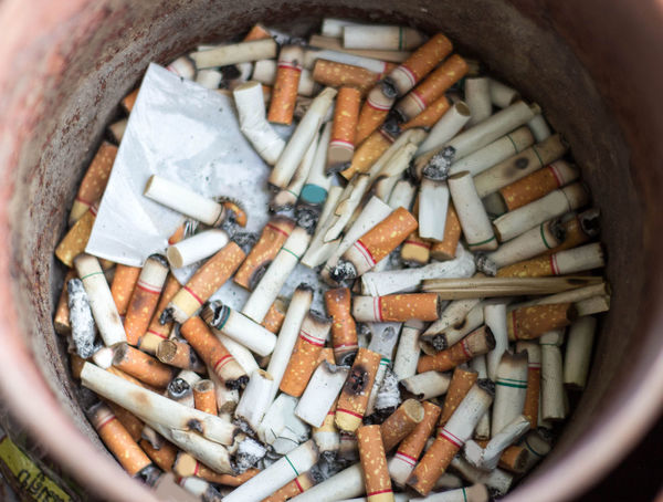 Cigarette butts stacked Abundance Addiction Ash Ashtray  Bad Habit Cigarette  Cigarette Butt Close-up Danger Day Directly Above Excess Indoors  Large Group Of Objects No People RISK Smoking Issues Social Issues
