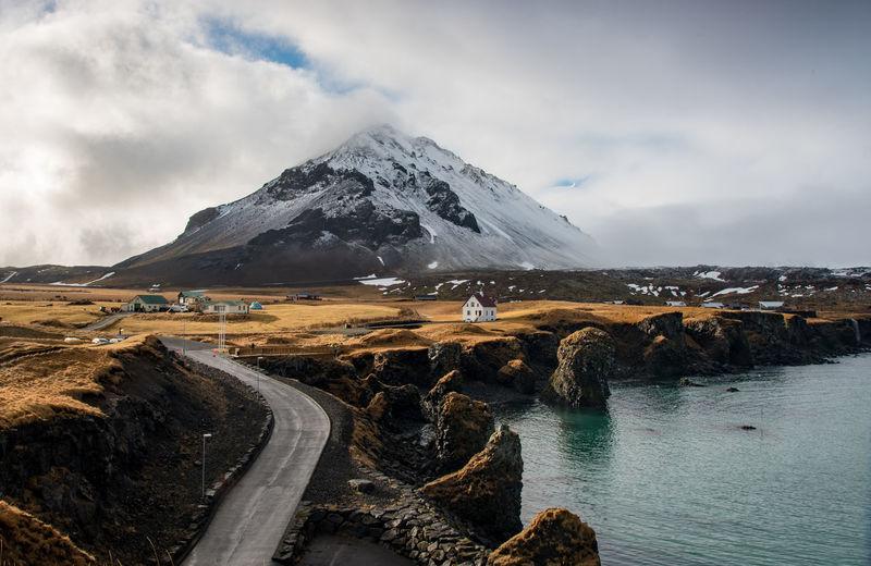 Scenic view of snowcapped mountains against sky. arnarstapi iceland