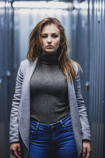 Beautiful Woman Casual Clothing Clothing Focus On Foreground Front View Hair Hairstyle Indoors  Jeans Lifestyles Long Hair Looking At Camera One Person Portrait Real People Standing Teenager Three Quarter Length Waist Up Young Adult Young Women