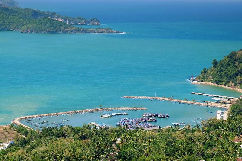 Pacitan Bay Water Sea Plant Land Nature Tree Scenics - Nature Outdoors Travel Destinations Architecture No People Tranquility Blue Tranquil Scene Nautical Vessel High Angle View Sky Beauty In Nature Beach Day