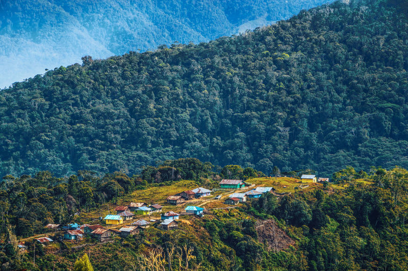 High angle view of trees and houses against mountains