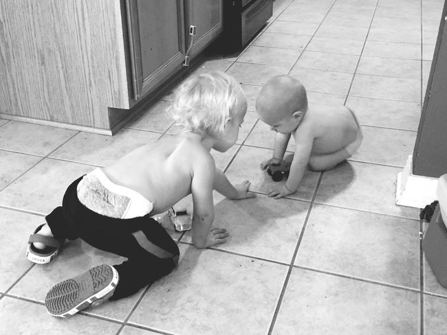 Brothers playing with trucks