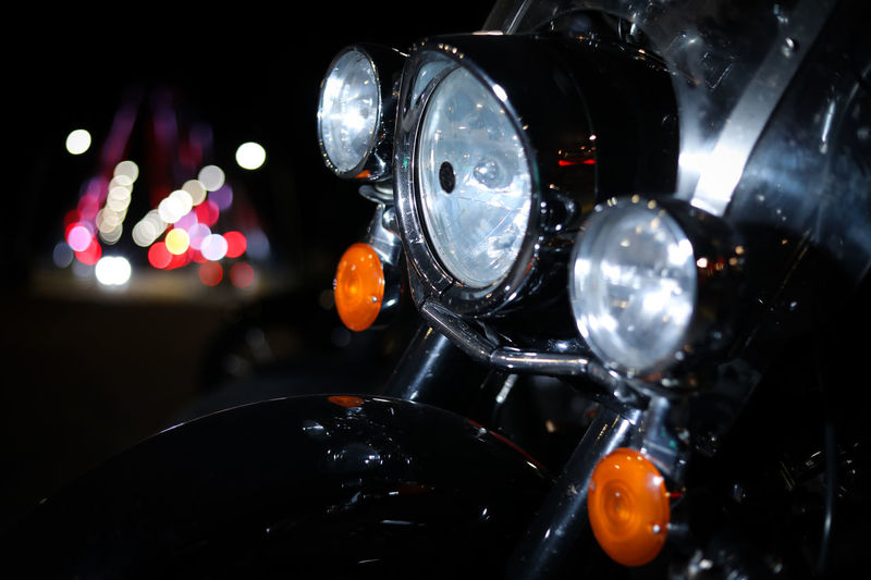 Close-up No People Indoors  Illuminated Lighting Equipment Selective Focus Orange Color Focus On Foreground Food And Drink Motorcycle Mode Of Transportation Metal Transportation Food Black Color Dark Light Lens Flare Multi Colored