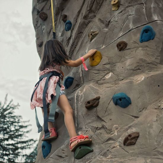 Rock climbing in pink sandals. Trying New Things Pink Rock Wall Perseverance Strength Kids Girl Power Rock Climbing Outdoors Sandals Original Experiences Feel The Journey Millennial Pink