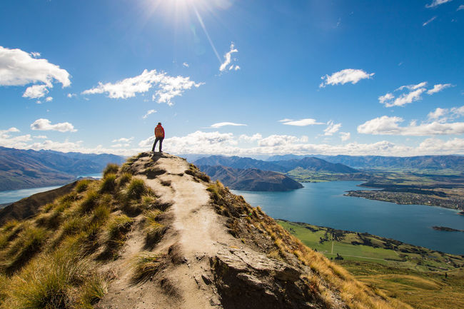 young woman standing on the roys peak lookout and watching over the moutains and lake wanaka on a beautiful atumn day Wanaka Adventure Beauty In Nature Cloud - Sky Day Hiking Idyllic Leisure Activity Lifestyles Mountain Mountain Range Nature New Zealand Non-urban Scene One Person Outdoors Real People Roys Peak Scenics - Nature Sky Standing Sunlight Tranquil Scene Tranquility Water The Traveler - 2018 EyeEm Awards