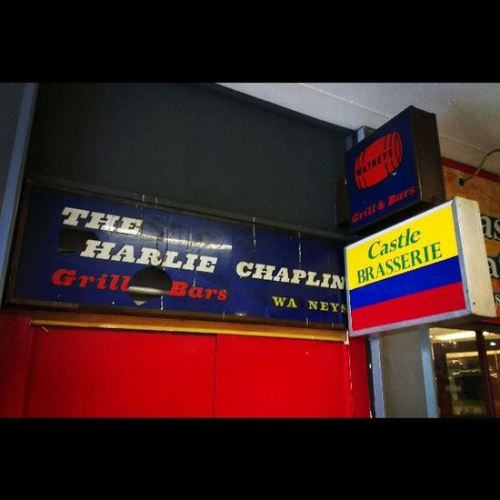 """""""The Charlie Chaplin"""" - old retro 60's sign."""