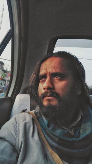 Thoughtful man sitting in car