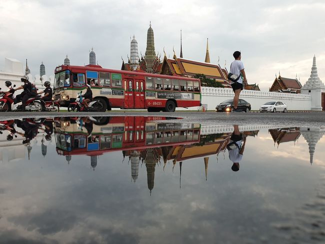 Temple of the Emerald Buddha, Thailand Tourist Tourism Thailand Bangkok Temple Reflection Water Sky Cloud - Sky Architecture Waterfront Real People Day City Transportation Outdoors