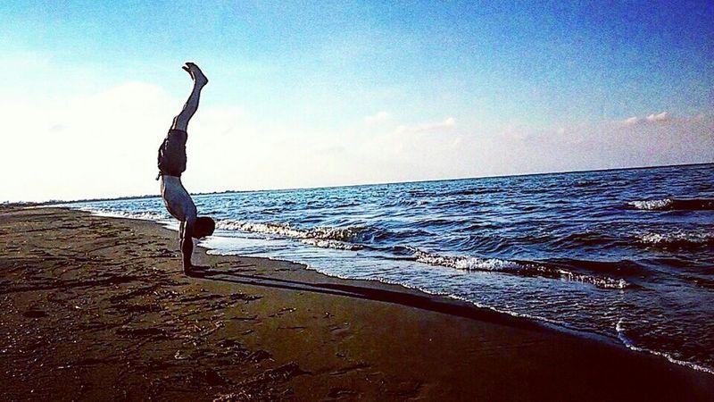 Sea One Person Beach Outside Water Sky Nature Blacksea Capoeira In Beach View Outdoor Nature Handstand  Handstandeveryday Sport Freestyle Sunset Yogachallenge Yogaeverydamnday Yogaeverywhere Yoga Blue Fun Yoga Practice Summer