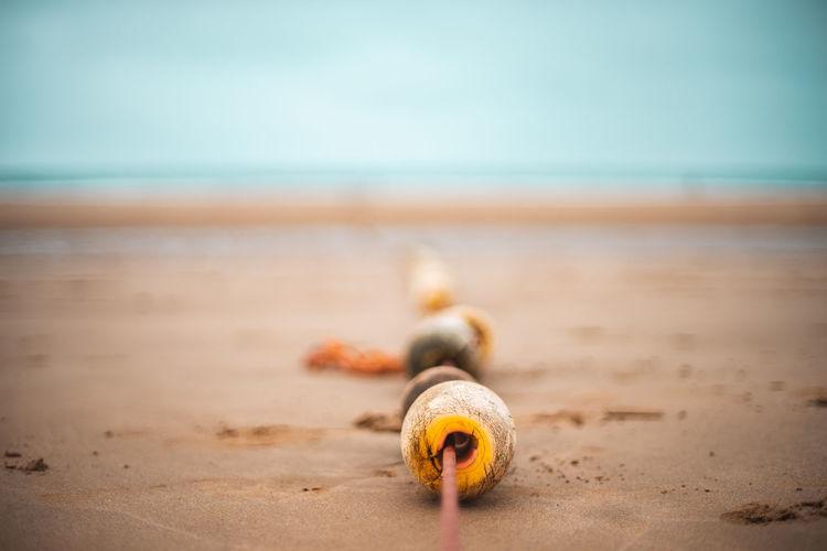 Buoys On Shore At Beach