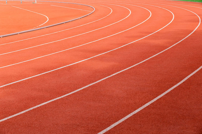 Full frame shot of orange track and field