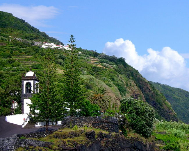 A partial view of the Church of Santa Bárbara on the island of São Jorge - Azores, Portugal Architecture Azores Beauty In Nature Church Cloud - Sky Day Green Color Growth Island Lush Foliage Mountain Nature No People Outdoors Plant Portugal Scenics Sky São Jorge Tranquil Scene Tranquility Tree