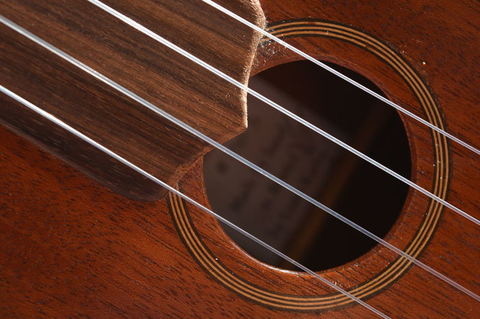 Ukulele. Close up of strings over sound hole. Arts And Entertainment Backgrounds Brown Close Up Close-up Day Full Frame Indoors  Music Musical Instrument No People Pattern Sound Hole Stringed Instrument Strings Uke Ukulele Lieblingsteil