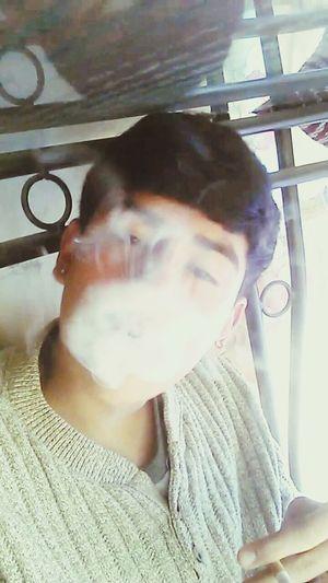 Fumando...