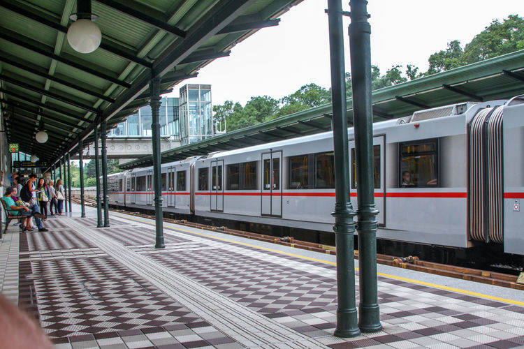 Train At Railroad Station In City