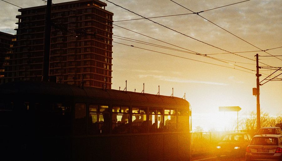 tram in a sunset EyeEm EyeEm Best Shots EyeEmNewHere EyeEm Gallery Lifestyles Analogue Photography 35mm Film Focus On Foreground Outdoors Sunset Cable Electricity  Sky Architecture Built Structure Power Line  Electricity Tower Train - Vehicle Rail Transportation Passenger Train Telephone Pole Train Interior Public Transportation Electricity Pylon Steam Train Railway Bridge Shunting Yard Telephone Line Electric Pole Metro Train Fuel And Power Generation