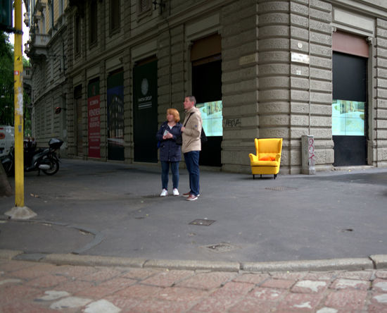 Adults Only Architecture Armchair Building Exterior City Day FREE ARMCHAIR Lifestyle Lifestyles Milano Outdoors People Real People Road Street Street Photo Streetphotography Two People Yellow Yellow Armchair