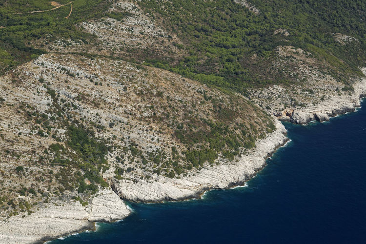 High angle view of rocks by sea