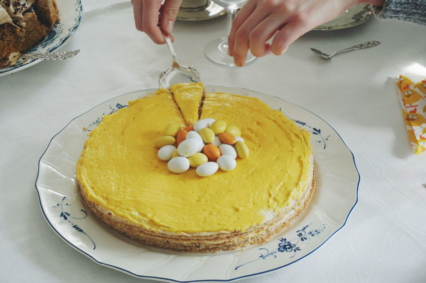 Easter cake Cake Celebration Dessert Easter Easter Easter Egg Easter Eggs Egg Food Food And Drink Freshness High Angle View Holding Human Body Part Human Hand Indoors  Indulgence One Person Plate Ready-to-eat Real People Sweet Food Temptation Yellow Yellow Color Visual Feast