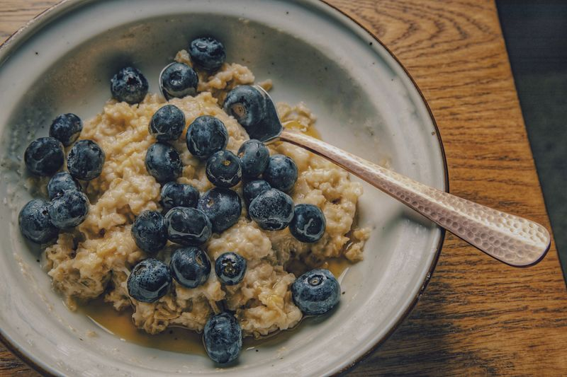 Oatmeal breakfast Oatmeal Food And Drink Food Healthy Eating Freshness Fruit Wellbeing Berry Fruit Blueberry Breakfast Indoors  Meal Table Eating Utensil High Angle View Still Life Ready-to-eat Kitchen Utensil Spoon Directly Above Bowl