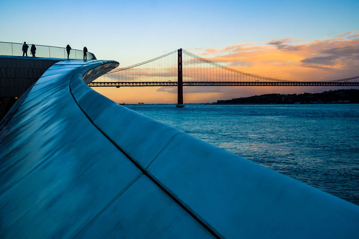 Architecture Architecture_collection Bridge Over Water Lisbon - Portugal MAAT Museum Maat, Portugal, Belem Sunset_collection The Week on EyeEm Architecture Bridge Bridge - Man Made Structure Built Structure Cloud - Sky Connection Lisbon Maat - Museum Museum Nature Outdoors Sea Sky Sunset Transportation Travel Water The Architect - 2018 EyeEm Awards #urbanana: The Urban Playground