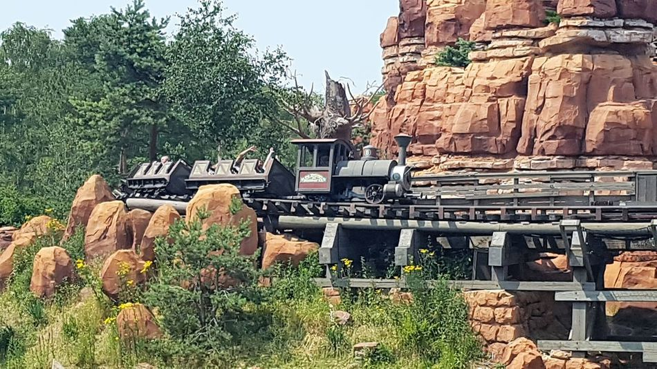 Here is a Photo shot of Big Thunder Mountain Railroad Train travelling around the mountain with adventures. This Shot was taken in 2017 in Frontierland - Disneyland Park - Disneyland Resort Paris. 2017 2017 Year Architecture Big Thunder Mountain Railroad Day Disneyland Paris Disneyland Paris 💚🎆🗼 Disneyland Resort Paris Disneyland Resort Paris 2017 Disneylandparis Eurodisney Eurodisneyland France France Trip Growth Nature No People Outdoors Paris, France  Rollercoaster Sky Stack Travel Destinations Travel Photography Tree