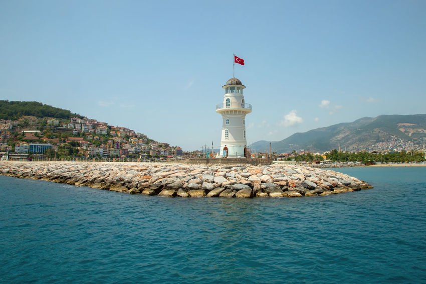 Alanya Lighthouse Alanya Harbor Lighthouse Mediterranean  Mediterranean Sea Turkey Architecture Bay Building Exterior Built Structure Clouds And Sky Guidance Mountain Range Nature Outdoors Protection Safety Security Sky Tower Travel Destinations Turkish Flag Water Waterfront
