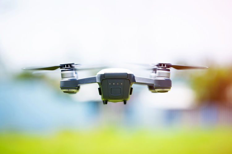 Small drones are flying in the air. Sky Flying Propeller Remote Camera Aerospace Industry Aggression  Air Vehicle Airplane Day Drone  Flying Focus On Foreground Mid-air Military Mode Of Transportation Motion No People Outdoors Security Speed Surveillance Technology