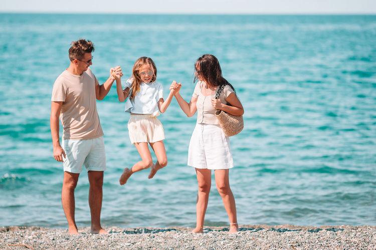 Full length of women standing on beach