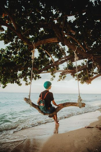 The paradise on the Thai islands Exotic Tropical Paradise Tropical Climate Tropical Tree Tropical Ocean View Ocean Water Tree Real People One Person Plant Lifestyles Nature Leisure Activity Beauty In Nature Beach Sitting Branch Sea Land Outdoors Full Length Day Men